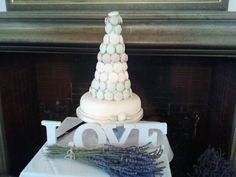 Macaron Wedding Tower. Have cake on its own table near bride and groom