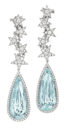 These fantastic aquamarine and diamond earrings at the work of Margherita Burgener. Those aquamarines weigh approximately 36.36 carats in total and are set in white gold, as are the accompanying diamonds. (Via Phillips.)