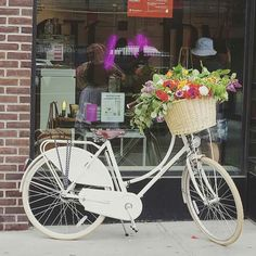 Bike with a basket of flowers.