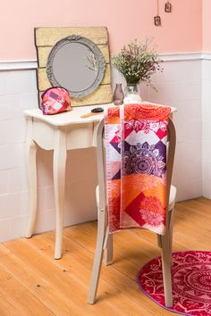 These plush peach prints, combined with the rustic DIY mirror are a match made in heaven!