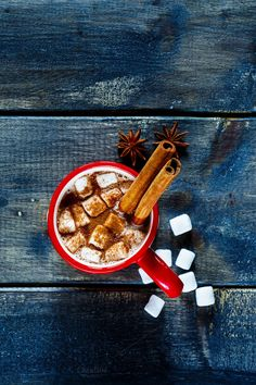 #Traditional hot chocolate  Top view of aromatic cocoa drink with marshmallows and cinnamon sticks over dark texture background. Traditional beverage for winter time.