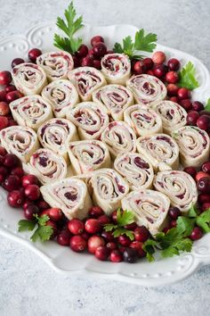 Cranberry Turkey Pinwheels, cranberry sauce, cajunturkey, and scallion cream cheese rolled in tortillas. The perfect holiday appetizer! Recipe from ThisSillyGirlsKitchen.com #pinwheels #rollups #appetizer