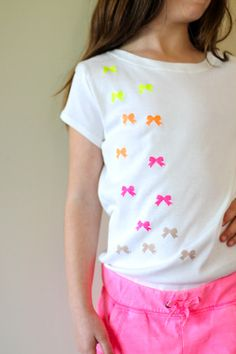DIY Stenciled T-shirts... So adorable. Wonder how it would look with blue stars for a boy?