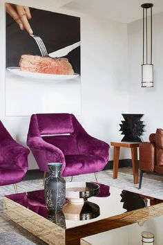 Modern And Bold Apartment With Mid-Century Touches   Purple upholstered chairs, gold mirror tables and creative oversized photos on the wall make the space unique