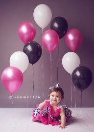 Tape balloons to the floor for photo shoot - one year birthday pic idea