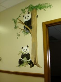 Panda's on the wall! In a church nursery, Noah's two x two's - a different pair for each nursery room door!