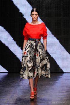 The 18-year-old worked a ladylike look in this blouse and skirt by Donna Karan, slicking her glossy, long locks back to show off a contoured, smokey eye. Rex -Cosmopolitan.co.uk