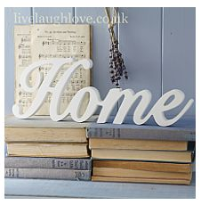 """Wood Script Word """"HOME""""- Large  The word """"Home"""" scripted in wood and painted white. Wall hanging or free standing on a shelf.  H13cm W36cm D1.5cm. From the site http://www.livelaughlove.co.uk/Wood-Script-Word-HOME-Large.html"""