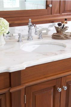White marble countertops juxtapose warm wood cabinetry in this timeless bath Bath Traditional by Sarah Blank Design Studio Best Kitchen Design, Small Bathroom Renovations, Mold In Bathroom, Industrial, Kitchen And Bath, Kitchen Reno, Kitchen Remodel, Hacks, Contemporary Bathrooms