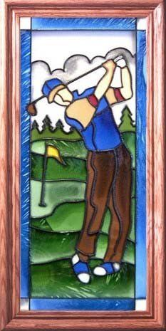 """Stained Glass Window - Male Golfer by Wisconsinmade. $55.50. Expertly crafted by Wisconsin artisans. Hand painted. Allow up to one week for processing. Medium oak frame, finished dimensions 11 1/2 x 22 1/2 in.. Perfect gift for your favorite golfer. This """"Male Golfer"""" stained glass creation is offered by Silver Creek Industries. The beauty of stained glass is captured in each hand-painted image by Wisconsin artisans. Using liquid glass stains and a leading compoun..."""
