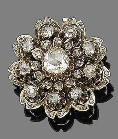A diamond brooch/pendant, circa 1880  Designed as a flowerhead, set throughout with rose-cut diamonds, the largest to the centre, mounted in gold, former Austro-Hungarian Empire assay marks, detachable brooch/pendant fitting with Viennese assay mark and indistinct maker's mark, length 2.9cm