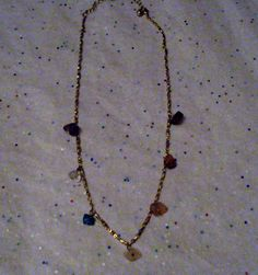 Avon Crystals  Gemstones Chakra Necklace: Avon Crystals  Gemstones Chakra Necklace Pretty necklace features the following gemstone chunks and crystals:  amethyst crystal quartz turquoise rose quartz citrine carnelian garnet  All on a fancy gold tone studded design chain with 3 chain extender. Lobster clasp. Necklace measures 16 long not including the extender chain. Sale only $16.99 + free shipping....