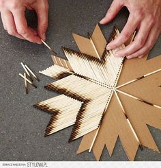 DIY cardboard and burnt matches snowflake decor. Cut out cardboard snowflake shape with Cricut Explore