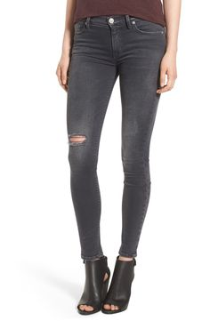 These versatile skinny jeans cut from in stretch-cotton denim feature a flattering silhouette that's slim from the waist to the ankle. This pair of distressed denim will be totally on trend when paired with sleek booties and a cable knit sweater.