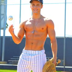 I doubt he's an actual baseball player but this is why baseball should be played shirtless.