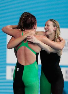Kylie Palmer, Brittany Elmslie and Bronte Barratt of Australia celebrate after the Swimming Women's Freestyle 4x200m Final on day thirteen of the 15th FINA World Championships at Palau Sant Jordi on August 1, 2013 in Barcelona, Spain.