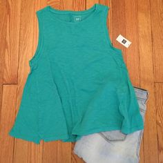 Gap top Never worn!! This top is amazing and I got it in each color(got this once twice by accident) Slight trapeze/swing style. 100% cotton. Looks adorable!! Pair with skinny jeans or shorts. Lightweight. I love this color! Great top for the warm summer days or nights  Pictured with Loft Bermuda shorts. For sale separately in my closet  GAP Tops