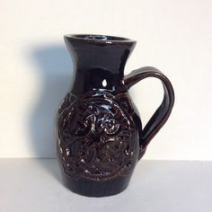 Eric Dunn Celtic pitcher Stoneware clay, glaze, carved design