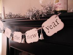 "new years party decorations ""ring in the new year"" sign banner garland. $18.00, via Etsy."