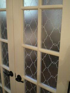 """I made this moroccan style window film by myself with a stencil, clear contact paper and a white paint pen. Only cost $7 to do 48"""" french doors. These doors separate our bedroom and living room area. This was much easier than cutting out the shapes individually. requires moderate skill level with lots of patience. took about 4 hours start to finish."""