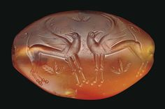 Mycenaean Carnelian Amygdaloid, Late Helladic III, C. 1375-1250 BCEngraved with two adorsed heraldic griffins, each standing with its crested and beaked head turned back, the forelegs extended, the hind legs bent, with raised sickle-shaped wings, the...