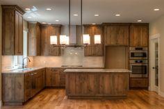 Kitchen, knotty alder cabinets, Bosch appliances, colonial creme granite