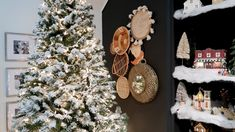 Add your lights if your tree is not already prelit. Then lay a cloth or trash bags under the tree to catch any snow fall out during the application process.