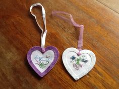 A lovely pair of handmade cross stitch hearts, matching the theme of lavender