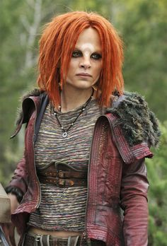 Irisa on Defiance (Costume designer Simonetta Mariano). I really dig all of the textures of the costume and the color palette. Crop top and a red leather jacket with fur trim.