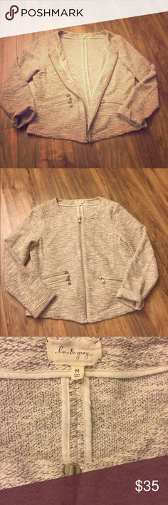 Anthropology Brand: Lou & Grey Sweater Jacket Effortlessly Chic; Lou & Grey Sweater Jacket; zip up with brushed silver zipper pocket detailing; color is grey, cream, and metallic thread to add sparkle; size M; 79% cotton, 17% polyester; 4% other fibers; good used condition Anthropologie Sweaters