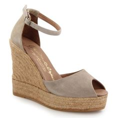 "Step out in style this summer in these gorgeous wedges from GAIMO Espadrilles. Featuring a subtle peep toe design with a sleek upper, a chic espadrille wedge and ankle strap for added support, these fun and fashionable sandals are the perfect blend of style and comfort. Surely a must-have!  romantic design an artisan shoe made by hand heel counter for perfect fit ankle strap trendy straw wedge foot friendly insole heel: 4.1"" platform: 1.4"" #gaimo #espadrilles"