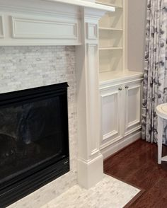 Living room fireplace with white marble mosaic, Sherwin Williams Ponder on walls