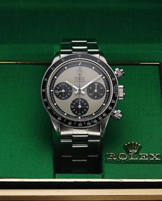 Oh how I wish I could buy this!!!!  Best valentines gift ever! Rolex Ref. 6264 Paul Newman Steel