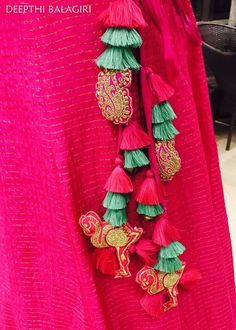 The ultimate list of gorgeous Lehenga and Blouse Latkan designs that are ruling the internet. From tassels to pom-pom designs, choose not just one but more. Sleeve Designs, Blouse Designs, Hippie Chic, Hand Embroidery, Embroidery Designs, Saree Tassels Designs, Diy Tassel, Indian Designer Wear, Fabric