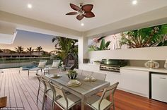 Outdoor dining: A vast entertaining balcony boasts impressive water views, a swimming pool...