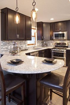 JAVA CABINETS; LIGHT COLORED FLOOR GREY ROCK BACKSPLASH