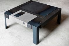 The 'floppytable' reminds us of a time when we once used diskettes for keeping digital file, except now as a life-size piece of furniturefor storing material things. the hot-rolled steel table byaxel van exel and marian neulantfeatures a 'metal shutter' typical of floppy diskswhich can be slid across the length of the table revealing a storage area. each hand-made unit is lasered with a serial number as a mark of authenticity.