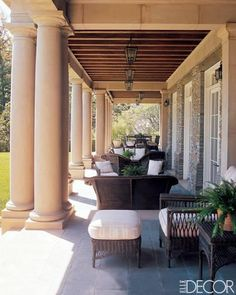 An elegant Beverly Hills veranda decorated with gorgeous wicker furniture.