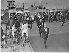 1960's. The IJ ferry number 24 has arrived at De Ruijterkade on the back-side of het Centraal Station. Before the IJ tunnel was established in 1968 all transportation between Amsterdam Noord and the center of Amsterdam took place through ferries. Photo Dolf Toussaint.