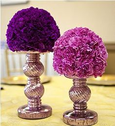 different size silver candlesticks will hold small bouquets of carnations and hydrangeas (green and purple) for the center pieces. they will be placed on mirrors surrounded by tea lights.