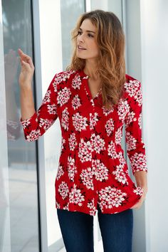 Floral Print Red Pintuck Jersey Top - This simple, floral print jersey shirt is perfect for work or for weekends. A cool and relaxed feminine fit, with pretty pintuck detail and button through opening. Team with your favourite jeans for a smart casual look.