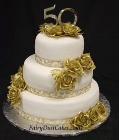 gold 50th wedding anniversary cake | Gold Wedding Anniversary Cake Golden Anniversary Cake, 50th Wedding Anniversary Cakes, Gold And White Cake, 50th Cake, Beautiful Wedding Cakes, Celebration Cakes, Cake Decorating, Gold Wedding, 50th Birthday