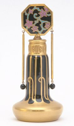 1920s DEVILBISS Perfume bottle in enameled and gilded glass with gilded metal and cloisonn' enamel stopper, suspended metal & glass ornaments