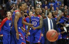 The Kansas Jayhawks go wild after a dunk by Andrew Wiggins, center, during the second half of the Champions Classic matchup on Tuesday, Nov. 12, 2013 at the United Center in Chicago. #KU