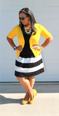 black and white striped pleated skirt with yellow cardigan and yellow wedges modest outfit idea