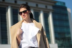 The perfect white shirt. Office outfit: white shirt, black pants and camel coat