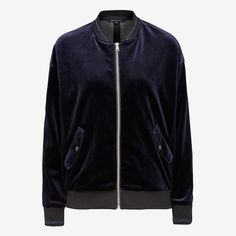Designed in a relaxed bomber jacket silhouette, that features two functional slip pockets, front zipper opening and navy metallic elastic rib detail on sleeve and body hem.  This bomber jacket is a key item crafted in this seasons must have fabric; velvet,  it will be your winter side kick. 100% POLYESTER, COLD HAND WASH