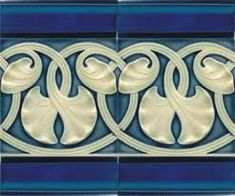 Art Nouveau Tiles in blue and white flower/ vine entwined pattern.