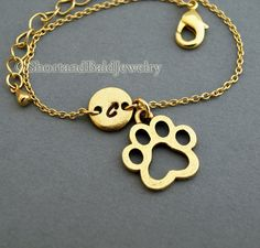Dog Paw charm bracelet, dog paw print, initial hand stamped, personalized, gold antique pewter, friendship bracelet, mothers bracelet. $19.75, via Etsy.