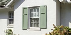 Green shutters on house.